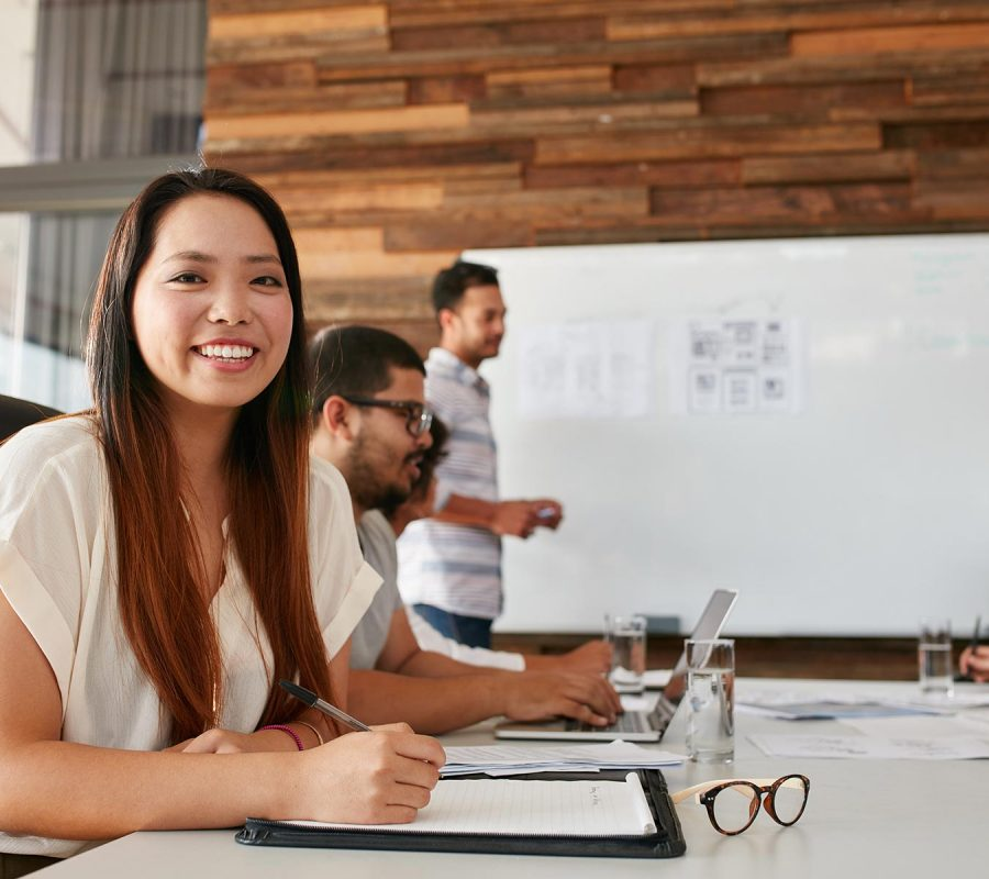 asian-woman-smiling-during-business-presentation-P2TRSSV.jpg